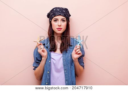 Young Redhead Girl In Bandana Holding Starfish