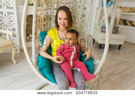 Mother And Mixed Race Baby Playing At Home.
