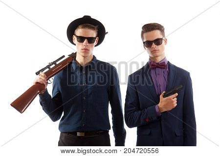 Two men with sunglasses holding their weapons