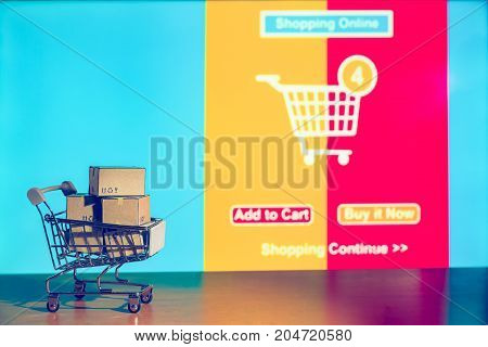 shopping background Cartons in shopping cart with ad order shopping scene background shopping online concept Business about internet of thing background.