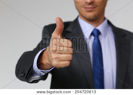 Male Hand Showing Ok Or Confirm Sign With Thumb Up