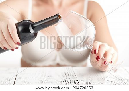 Woman With Nail Manicure Drink Red Wine From Glass