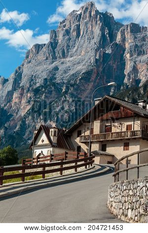 Typical House In European Alps Mountain's Scenery And Winding Road In Summer Time