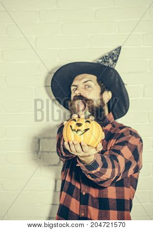 Halloween Man With Pumpkin On White Brick Wall