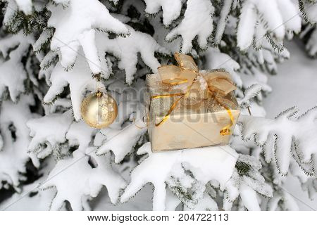 Christmas Present And Ball On White Snow