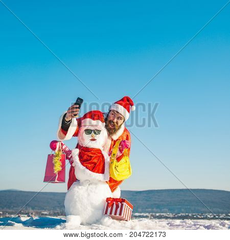 Santa Man Making Selfie With Snowman