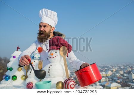 Excited Man In Chef Hat Ladling Soup On Winter Day