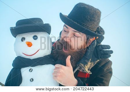 Snowman With Smiley Face In Gloves