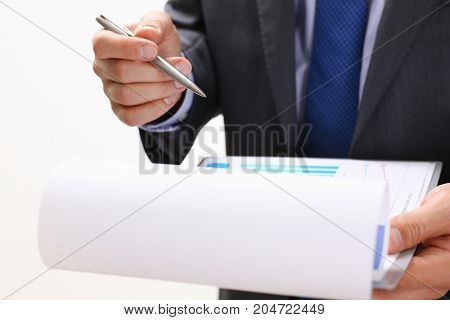 Male Hand Holding Silver Pen