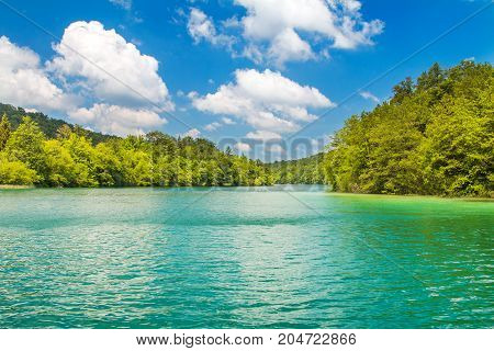 Beautiful landscape, waterfall and clear green water in the Plitvice Lakes National Park in Croatia