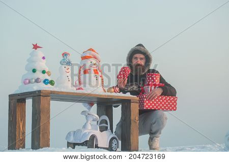 Unhappy Man Holding Gift Boxes