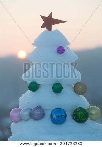 Christmas Tree With Baubles On Sunset Sky