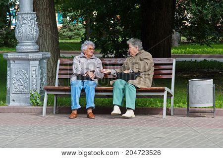 Volgograd Russia - September 11 2011: Elderly women sitting on bench in the park in Volgograd