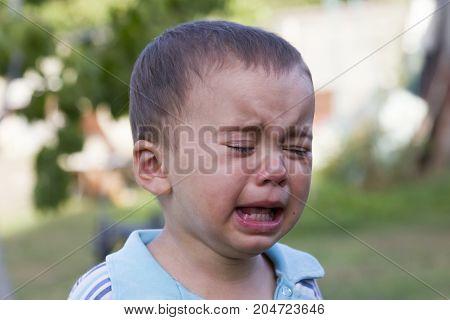 Kid Crying Very Loud On The Street