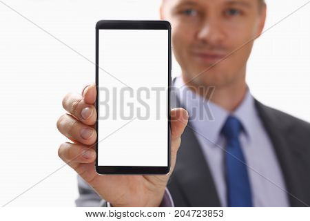 Businessman Holds A New Smartphone In His Hand