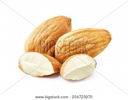 Almond nuts. Slices of almond nuts isolated on white background with clipping path. Macro photography with great depth of field. DoF .
