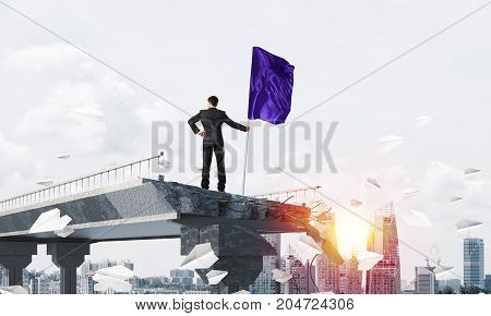 Rear view of confident businessman in suit holding flag in hand while standing among flying paper planes on broken bridge with cityscape and sunlight on background. 3D rendering.