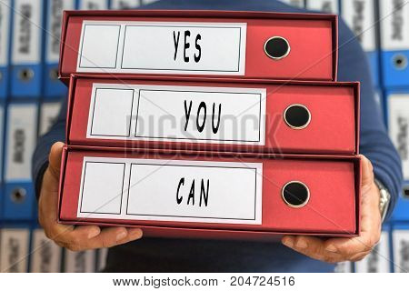 Yes, You, Can Concept Words. Folder Concept. Ring Binders.