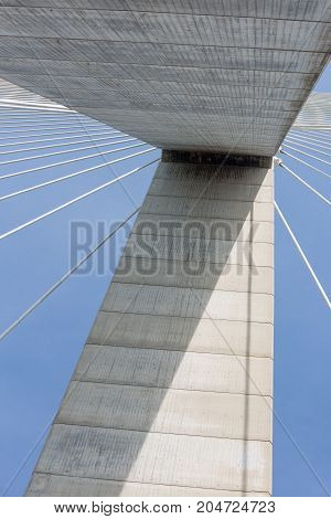 Bottom view of concrete pylon with steel cables from Pont de Normandie over river Seine in France