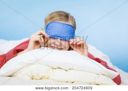 Young Woman Wearing Sleeping Eye Band In Bed
