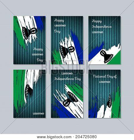 Lesotho Patriotic Cards For National Day. Expressive Brush Stroke In National Flag Colors On Dark St