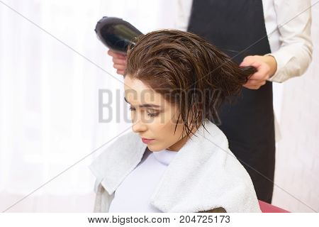 Woman at the hairdresser. Girl with wet hair.