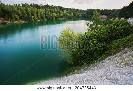 Lake with blue water. Beautiful scenery of Belarus. Cretaceous quarries near Grodno. A beautiful lake. Lake with blue water. The lake in Belarus. The lake in the forest coring, Lake in forest. Blue lake