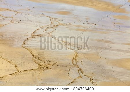 Detail of wet sand on a beach after the waves.