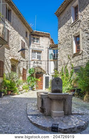 SAINT-PAUL-DE-VENCE FRANCE - APRIL 25 2016: Street of Saint-Paul-de-Vence one of the oldest medieval towns on the French Riviera well known for its modern and contemporary art museums and galleries France