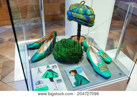 Riga, Latvia - August 2, 2011 - Casual fashion accessories of 50s. Green, blue hats, shoes with abstract ornaments. Fashion exhibition. Rare photo for articles, magazines, web, design, ideas.