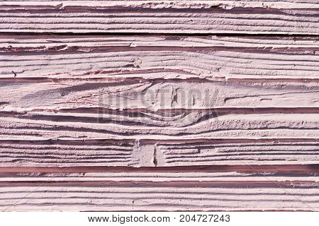 Wooden, cement, stone or gypsum texture colored in pink. Background. Copy space