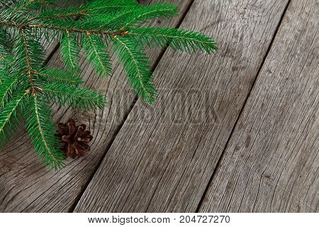Christmas decoration, frame concept background, top view with copy space on gray rustic wood table surface. Christmas ornaments border with fir tree branches and cones