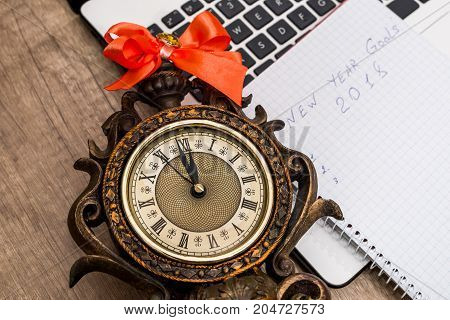 old clock with notepad - close up