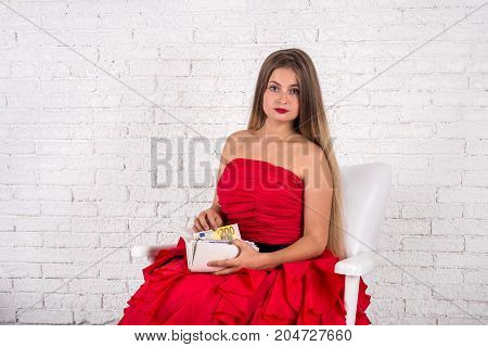 Finance Or Saving  Concept - Girl Holding Wallet With Euro Banknotes