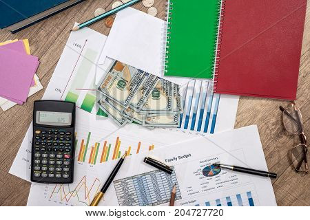Finance Concept - Money, Business Graph, Pen, Notepad, Calculator