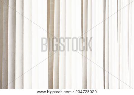 Classic antique pillars background. Texture of white greek columns