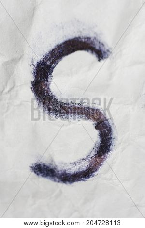 Hand writted black s letter on crumpled paper texture. Depressive symbol in terrible style