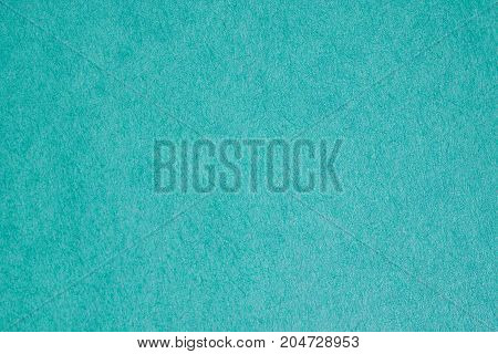 Greeny turquoise paper texture. Clean background for text