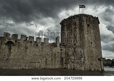 Tower and walls of Venetian fortress in the town of Trogir in Croatia