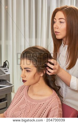 Young caucasian woman, hair salon. Hairdresser working with her client.