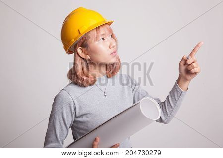 Asian Engineer Woman Pointing With Blueprints.