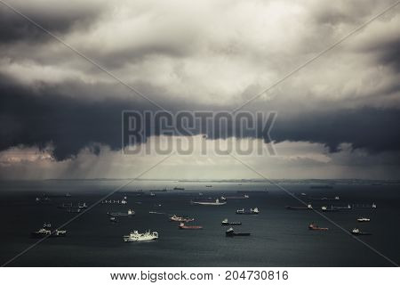 The coming storm and ships in Straits of Singapore from the view point on the Jin Shan Lou (Marina Bay Sands Hotel). Singapore
