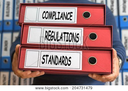 Regulations, Compliance, Standards, Concept Words. Folder Concept. Ring Binders.