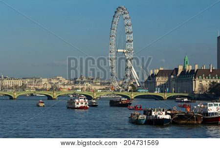 London, United Kingdom-November 11, 2016 : The London County hall is the site of business and attraction on the South bank of the River Thames.The London Eye is a giant wheel and the most popular attraction in the UK.