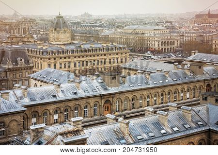 Spectacular image of Paris roofs from Cathedral Notre-Dame de Paris. Hopital Hotel-Dieu, above and Registry of the Paris Commercial Court below. France. Paris