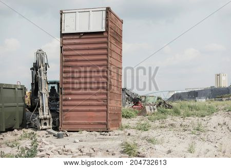 Container At Construction Site With Cloudy Sky.