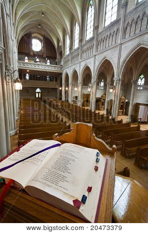 Catholic Church Interior, From The Pulpit. Open Bible In Foreground.