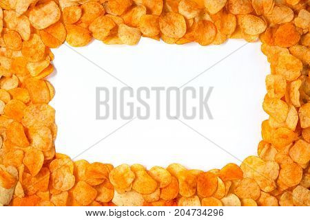 Golden Chips Potato Texture. Food Background Of Delicious Potato Chips With White Space In The Cente