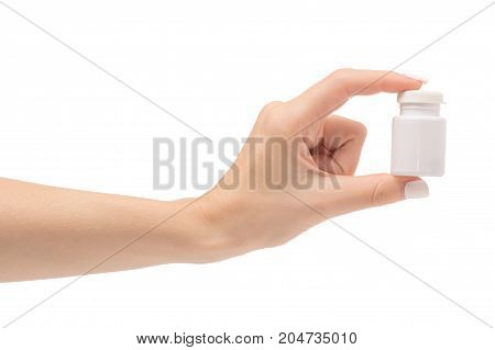 Female hands with a pot with pills on a white background isolation