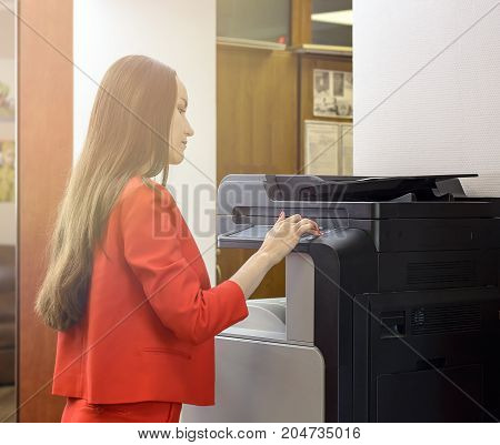 Young Secretary Woman Making Photocopies At The Office.